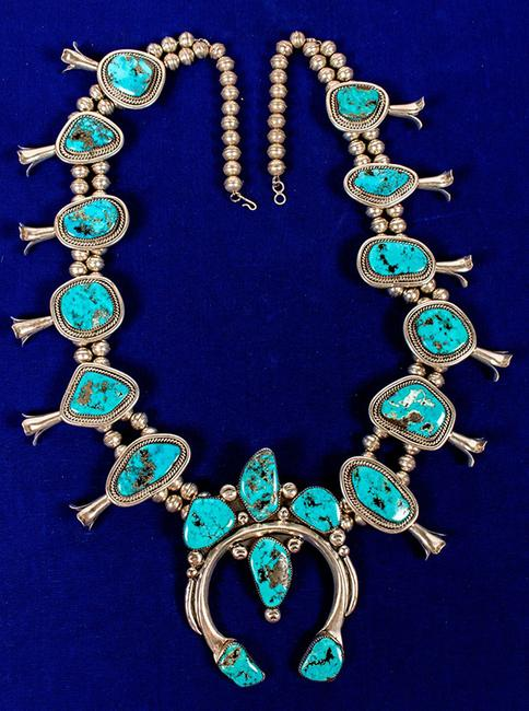 "Spectacular silver and exquisite sky-blue turquoise squash blossom necklace, circa 1950s or '60s, ""the finest one we've ever seen,"" according to Fred Holabird (est.  $3,000-$4,000)."