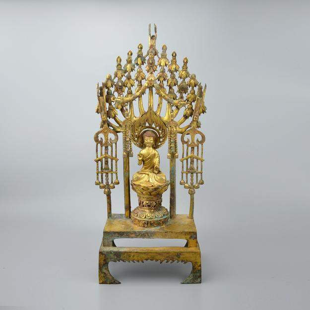 Sui Dynasty gilt-bronze altarpiece of Buddha Maitreya with seven Buddha on lotus blossom thrones.  Gianguan Auctions, March, 2018.