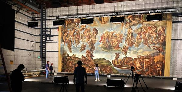 "Backdrop replicating Michelangelo's ""The Last Judgement,"" made for Metro - Goldwyn - Mayer Studios' film The Shoes of the Fisherman (1968).  Courtesy of the Art Directors Guild Archives; JC Backings; and Melinda Sue Gordon, Society of Motion Picture Still Photographers"