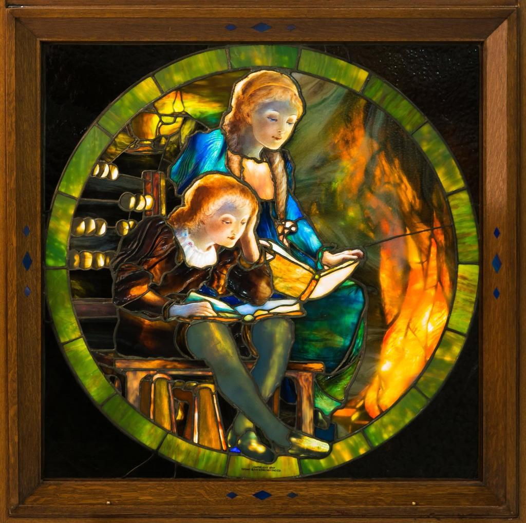 Wonderful 1897 Tiffany Studios (N.Y) window depicting two children reading by the fire, (est.  $40,000-$60,000)