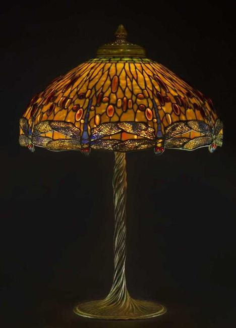 The top lot of the auction was this Tiffany Studios (N.Y.) drop head Dragonfly lamp, circa 1910, having a verdigris patinated leaded glass shade with 'jewel' cabochons ($200,000).