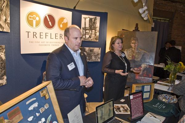 David Manzi, President of Trefler's, and Janet Moran, Head Painting Conservator at Trefler's, giving a booth talk on painting restoration.