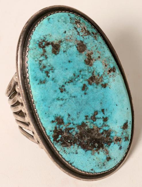 Indian cuff silver bracelet with a prominent Kingman turquoise stone, measuring 4 inches by 2 ¼ inches.  The sterling cuff was 6 inches.  The bracelet brought $2,250.
