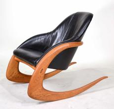 Black leather crescent rocker designed by Wendell Castle (Am., 1932-2018) ($17,500).