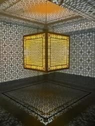 Anila Quayyum Agha, Hidden Diamond - Saffron, 2019, laser-cut, lacquered steel, 48 × 48 × 48 inches/122 × 122 × 122 cm