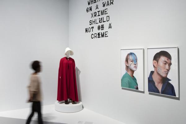 Installation view of Designs for Different Futures (Powers), featuring Handmaid's Costume, 2017, by Ane Crabtree, courtesy MGM Television; ZXX Typeface, 2012, by Sang Mun; and CV Dazzle: Camouflage from Face Detection, 2017, by Adam Harvey.  Photo by Juan Arce, courtesy Philadelphia Museum of Art, 2019.