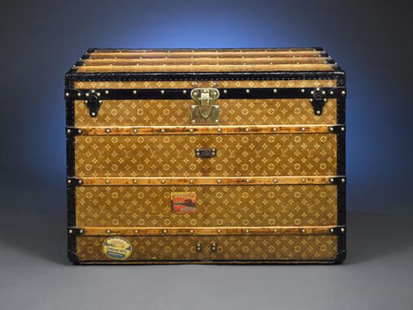 This captivating circa 1900 Louis Vuitton trunk exemplifies the style and grace of the golden age of travel.  This flat-top steamer case is covered with the familiar LV monogram on an early light brown handwoven canvas, and is finished with all original trim, including the marked latch metal trim, leather tags, beechwood slats and brass rivets.  Hotel stickers from around the globe attest to this trunk's travels far and wide.