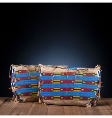 Cheyenne Beaded Hide Possible Bags, Matched Pair.  Fourth Quarter Nineteenth Century.  Price Realized: $31,250