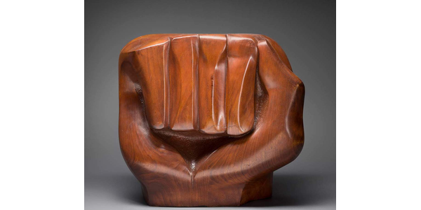 """From the traveling exhibition """"Soul of a Nation: Art in the Age of Black Power 1963–1983,"""" Elizabeth Catlett, """"Black Unity,"""" 1968.  Cedar, 21 in.  × 12 1/2 in.  × 23 in.  (53.3 × 31.8 × 58.4 cm).  Crystal Bridges Museum of American Art, Bentonville, Arkansas, 2014.11.  Photograph by Edward C.  Robison III © 2019 Catlett Mora Family Trust / Licensed by VAGA at Artists Rights Society (ARS), NY"""