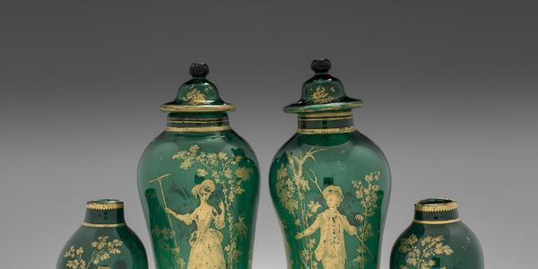 Pair of covered green vases, about 1765.  Probably the workshop of James Giles.  England, London.  Gilded copper-green lead glass.  H.  39.3 cm; Diam.  (max) 14.1 cm; and H.  39.7 cm; Diam.  (max) 13.9 cm.  The Corning Museum of Glass.