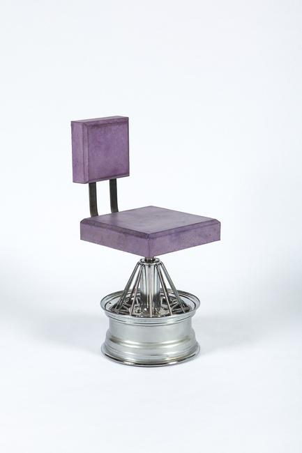 Dozie Kanu, Chair [ iii ], 2018.  Poured concrete, steel, rims, 37 × 19 × 16 1/2 in.  Courtesy the artist and Salon 94.