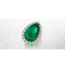 Lot 50: The Wakil Emerald Platinum, gold, emerald and diamond ring, Van Cleef & Arpels, circa 1974.