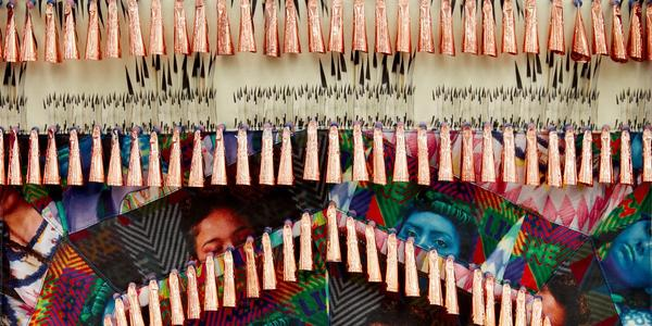 DETAIL: Jeffrey Gibson (Choctaw and Cherokee, b.  1972) The Anthropophagic Effect, Garment no.  2, 2019.  Canvas, cotton, vinyl, brass grommets, nylon thread, artificial sinew, dried pear gourds, copper jingles, glass and plastic beads, nylon ribbon.  Overall: 58 x 72 inches © Jeffrey Gibson Photography by Jason Wyche