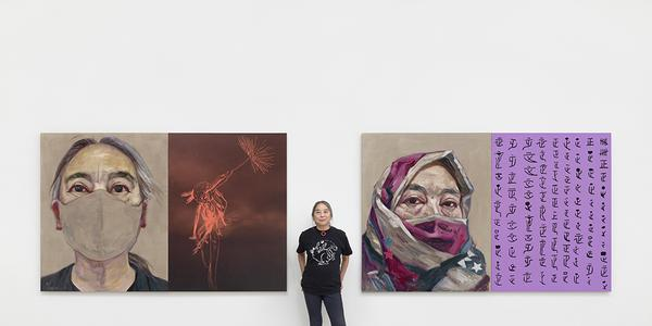 Hung Liu in her studio with Rat Year 2020, 2020; oil on linen and mixed media on wood panel, each: 64 x 100 in.  (162.6 x 254 cm), diptych.  Photo by John Janca.  Artwork © Hung Liu