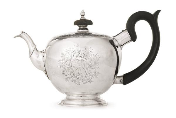 An Unusual American Silver Teapot Engraved with Hunters in a Landscape, Jacob Hurd, Boston, circa 1750 that more than doubled its pre-sale high estimate to sell for $278,500.