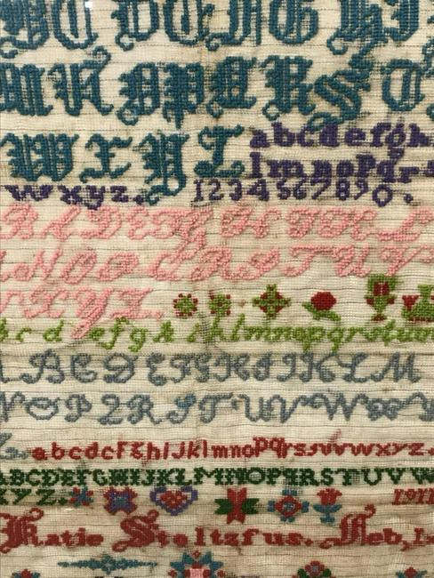 Among alphabet samplers is a Pennsylvania Amish sampler wrought by Katie Stoltzfus dated February 1, 1911, 25 ¾ by 18¼ inches.
