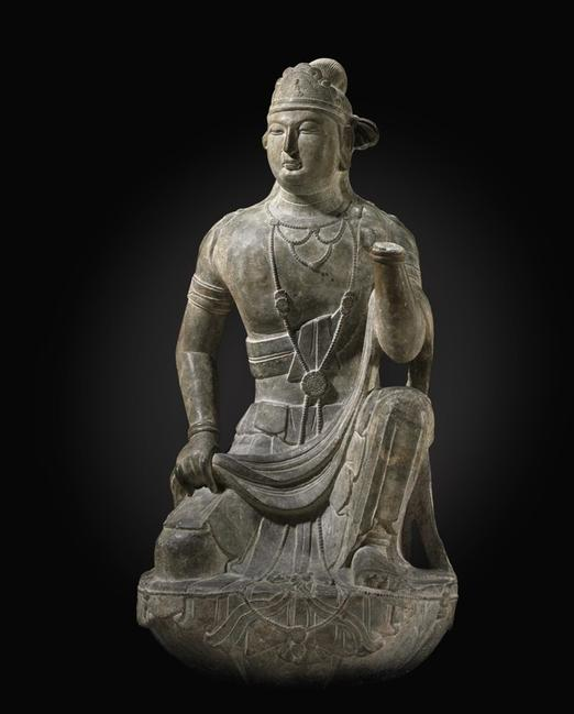From the Arthur M.  Sackler Collections, a very rare large limestone figure of a kneeling Bodhisattva, 10th/12th Century, realized $914,500 at Christie's.  (© Christie's Images Limited 2010 )