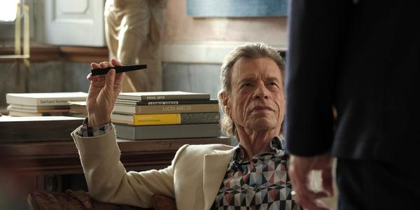 Mick Jagger as Joseph Cassidy, a high-powered art dealer, in The Burnt Orange Heresy.