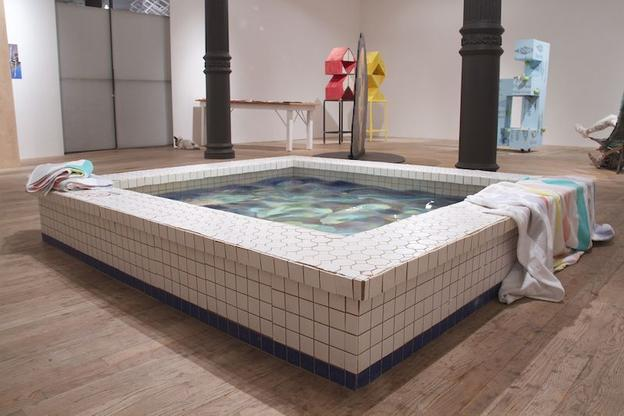 "Caitlin Cherry ""Mute City, Big Blue, Port Town"", 2014.  Swimming pool (wood, ceramic tiles, plexiglass, water, chlorine) mounted over painting (oil on canvas), beach towels.  87 x 79.5 x 12 in."