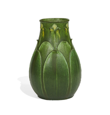 LOT 815: Marie A.  Seaman for Grueby, fine two-color vase with carved trefoil flowers and overlapping leaves.  Estimate $15,000-25,000