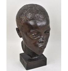 A bronze bust sculpture of an African-American Male attributed to Augusta Christine Savage (American, 1900-1962)