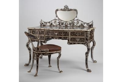 Martelé Writing Table and Chair, 1903, Gorham Manufacturing Company (est.  1831), United States, ebony, mahogany, boxwood, redwood, thuya wood, ivory, mother-of-pearl, silver, mirrored glass, and gilded tooled leather, Gift of Mr.  and Mrs.  Frederick B.  Thurber, RISD Museum, Providence, RI