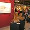 Boston International Fine Art Show attendees explore works in the booth of Lawrence Fine Art (NY)