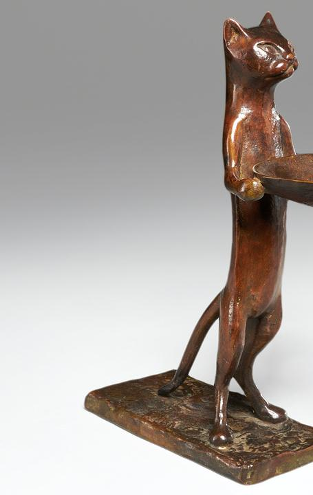 "The top lot of the auction was this Diego Giacometti cast bronze,""Chat maitre-d'hotel,"" circa 1967, in a pleasing reddish-brown patina, that earned $81,250.  It and many of the sale's other top lots came from the collection of Eugene V.  and Clare E.  Thaw."