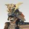 A red-laced armor with two-piece cuirass (Aka-odoshi Nimai-do gusoku) together with saddle and accessories Edo period (18th century) Estimate: $180,000-220,000