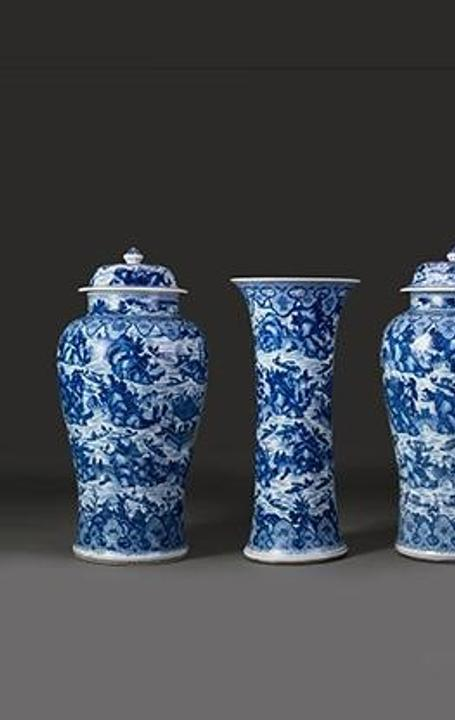 Garniture with scenes of West Lake, ca.  1700.  China, Qing dynasty (1644-1911).  Porcelain painted with cobalt blue under a transparent glaze; Jars, H.  40 3/4 in., Vases, H.  35 5/8 in.  R.  Albuquerque Collection