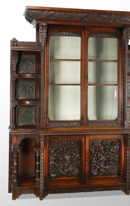 This gorgeous Cincinnati art carved cabinet sold for $7,400 -- to a descendant of the maker, William Fry.