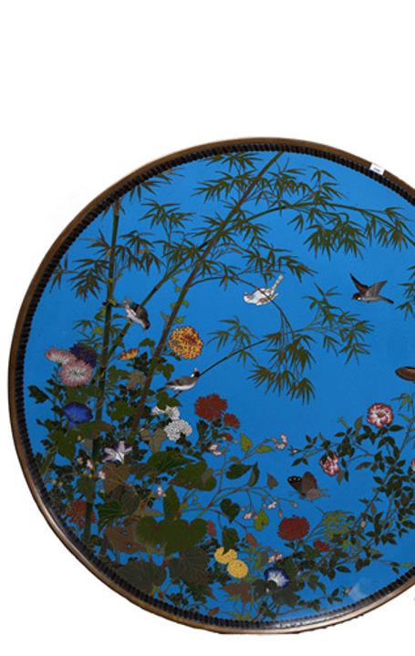 Massive pair of cloisonne chargers, each one 36 inches in diameter, featuring a beautiful blue background with colorful bamboo, floral, butterfly and bird motif.
