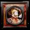 One of a pair of French enamel on copper round portrait plaques, this one of a Renaissance man, the other of a woman.