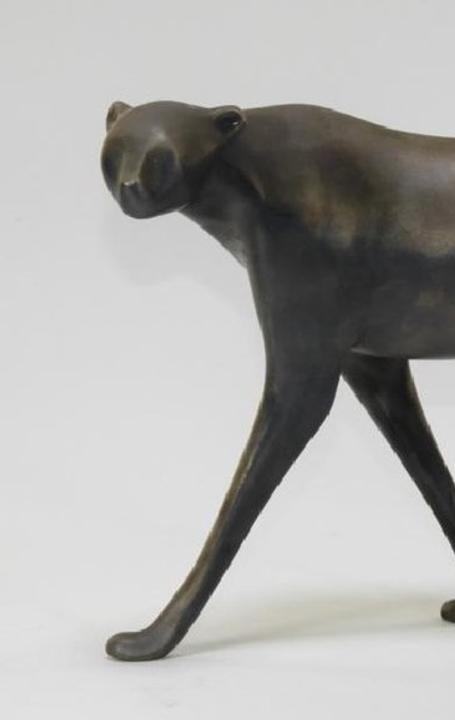 Sleek .999 silver sculpture of a cheetah, 14.5 inches in length, by the Dutch-American artist Loet Vanderveen (1921-2015), titled Stalking Cheetah ($3,750).