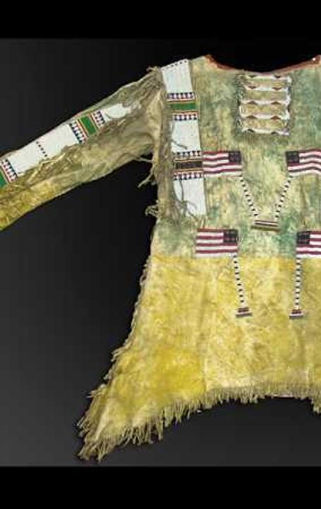 The top lot of the auction was this late 1800s sinew sewn hide Sioux war shirt with lazy stitch beading that sold for $27,500.