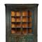 An early 19th century Painted Corner Cupboard attributed to the Ralph family from Sussex County, Delaware.  Estimate $2,500-5,000