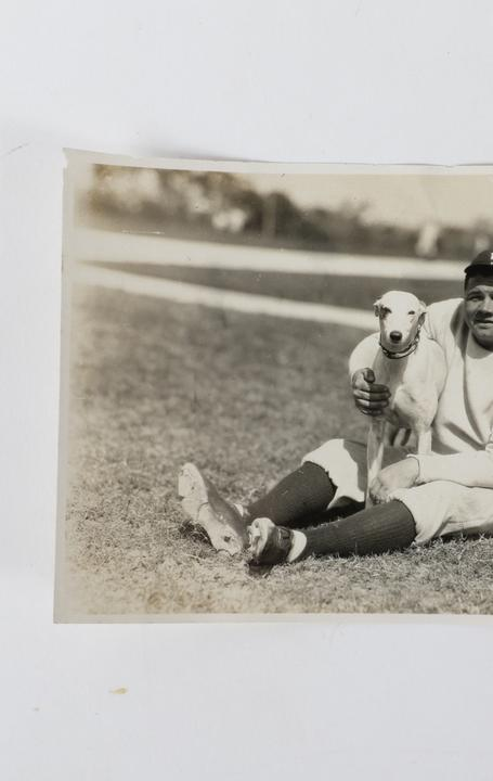 Babe Ruth pictured with a greyhound dog Hazel, who belonged to the very Midwestern family that compiled the photo album discovered in the storage facility.