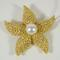 18kt yellow gold diamond and pearl starfish pin.