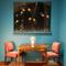 "Kirkland Museum's Art Deco vignette featuring the Dubly Games Table (c.  1927) and Drouant Chairs with original upholstery (1924) designed by Émile - Jacques Ruhlmann; 6 - Panel Lacquered Wood S creen by Jean Dunand (1925 or before) featuring his signature ""Dunand Deco fish and water; "" Daum Lamp (c.  1928) ."