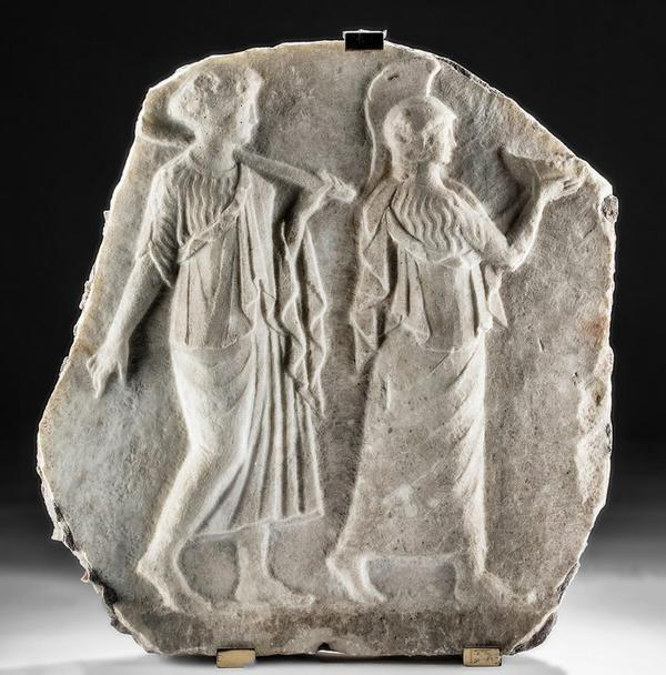 Marble relief of Minerva and Arachne, Roman Imperial Period, circa 1st to 2nd century CE, 18.1in high.  Accompanied by digital Art Loss Register Certificate.  Estimate $40,000-$60,000