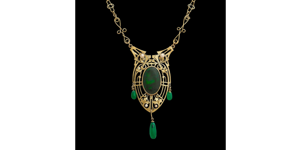 LOT 15: James H.  Winn pendant necklace on an original chain.  14K yellow gold, black opal, seed pearls, chrysoprase.  Sold for $23,750