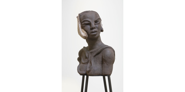WANGECHI MUTU, Detail of I am Speaking, Can you hear me?, 2020.  Paper pulp, wood glue, soil, charcoal, bone, feathers, shells, wood, metal stands 22 1/8 x 32 1/2 x 14 1/8 in.  (overall).  Courtesy of the Artist and Vielmetter Los Angeles.  Photo Credit Robert Wedemeyer