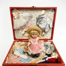 1952 Vogue Ginny 'Rich Uncle' special trunk set including Ginny doll with hang tag, numerous original factory outfits and accessories.  Near-mint.  Estimate $800-$1,200