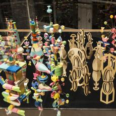 Pae White AGAMEMNOMICS (detail), 2013.  Toy pieces: Glass, wood, clay, porcelain, plastic, acrylic, rubber, ink, and paint Display case: Steel, glass, acrylic glass, and wood Collection of Pae White