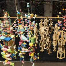 "Pae White ""AGAMEMNOMICS,"" 2013.  Toy pieces: Glass, wood, clay, porcelain, plastic, acrylic, rubber, ink, and paint Display case: Steel, glass, acrylic glass, and wood, 354 5/16 x 39 3/8 x 31 ½ inches.  Courtesy of the artist.  ""Beta Space: Pae White"" on view at the San José Museum of Art July 18, 2019–January 19, 2020."