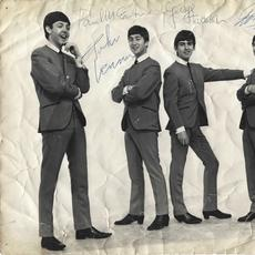 Vintage 8 inch by 10 inch photograph, featuring the Fab Four in their iconic, collarless suits, signed by all four Beatles – John, Paul, George and Ringo – in 1963, in blue ballpoint ink.