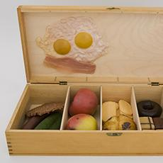 Claes Oldenburg, American, Designed by George Maciunas, American, Published by Fluxus, American, False Food Selection, 1966.  Wooden box with offset printed label, containing readymade plastic foods.  Harvard Art Museums/Fogg Museum, Barbara and Peter Moore Fluxus Collection, Margaret Fisher Fund and gift of Barbara Moore/Bound & Unbound, M26457.  © Claes Oldenburg.