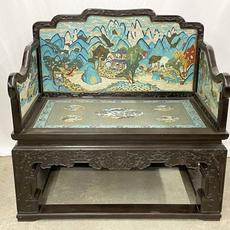 Fine Chinese rosewood hall bench with heavily-carved frame and elaborate cloisonné enamel landscape panels.  Auction estimate: $6,000-$10,000
