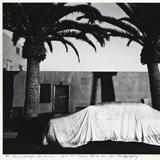 Robert Frank, Covered Car, Long Beach, California, silver print, 1955–56, printed 1971.  Estimate $50,000 to $70,000.
