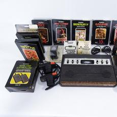 Atari Tele-games 2600 console and 10 video games, est.  $200-$400